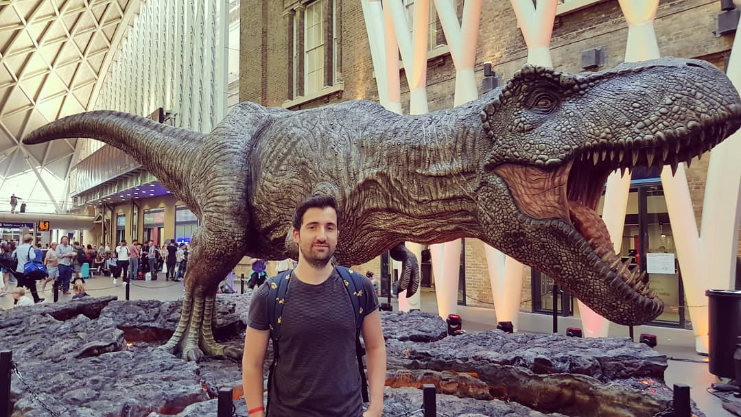 Picture of Marco Lilliu in front of a T-Rex